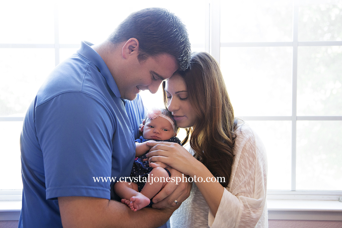 Lifestyle newborn portraits in your home