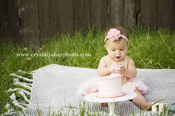 baby girl outdoor one year cake smash