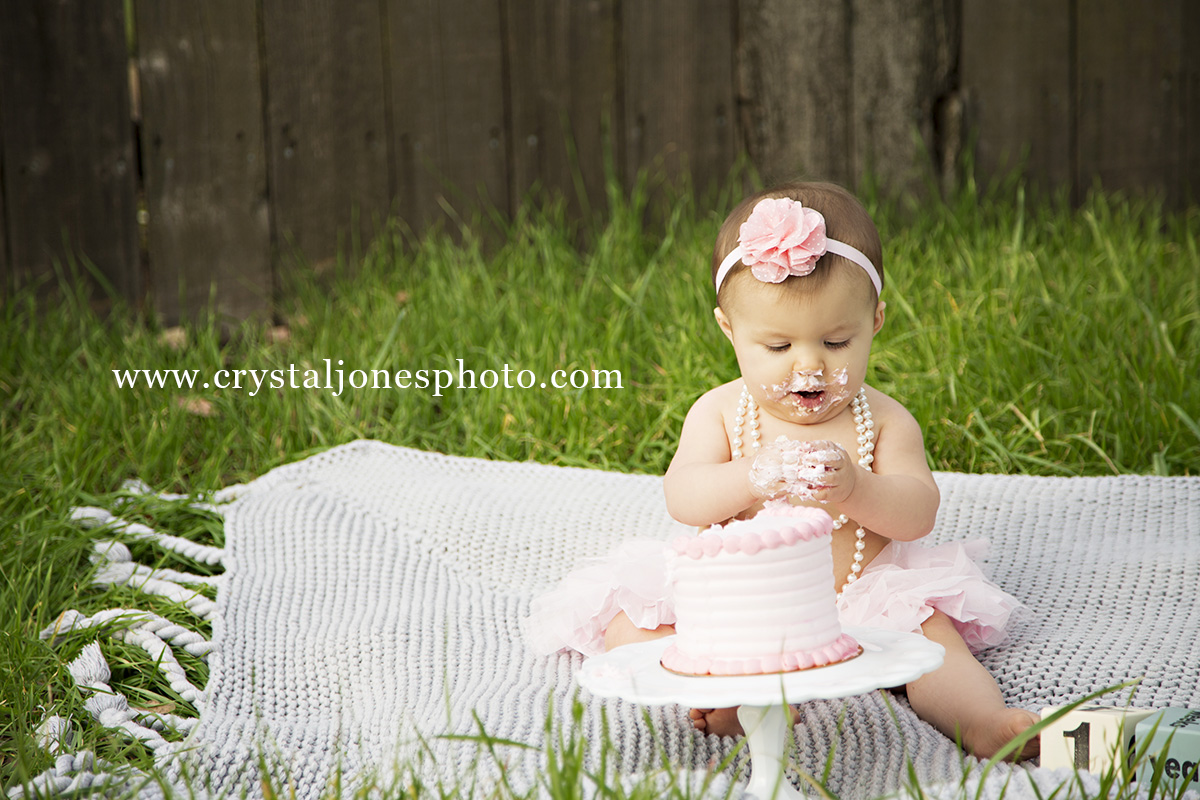 baby girl outdoor one year cake smash