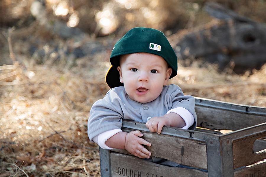 Adorable baby boy in baseball gear 012