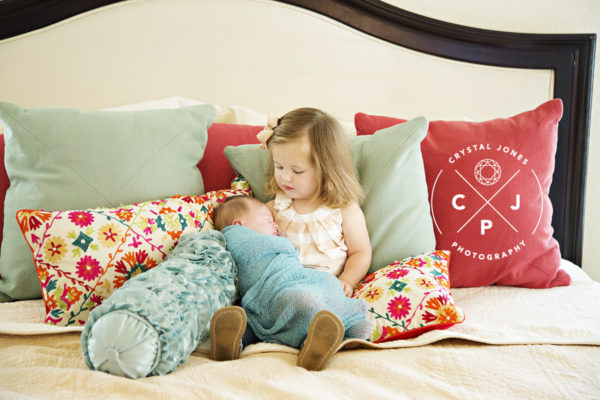 Sibling with newborn lifestyle photography