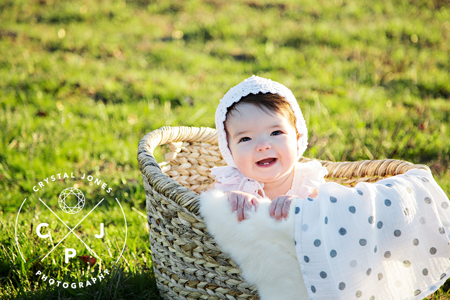 8 Month Old Baby Girl in a Basket in a Field