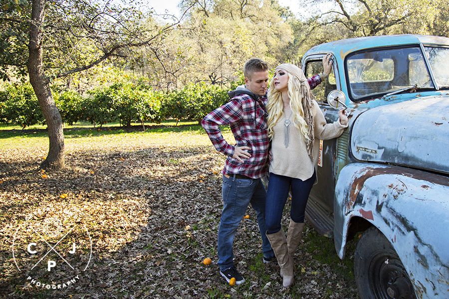 fun engagement portraits with old blue truck