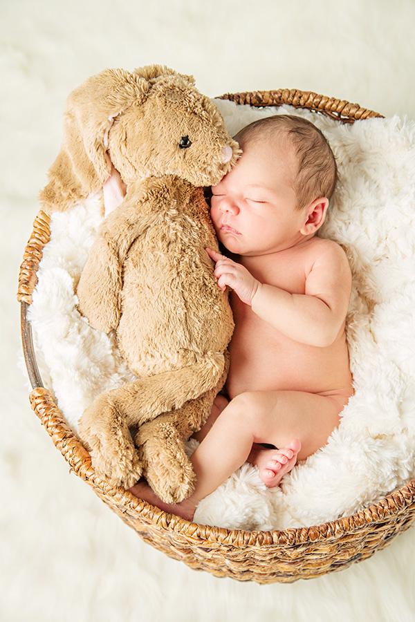 Sleeping Newborn Boy Hugging Stuffed Bunny