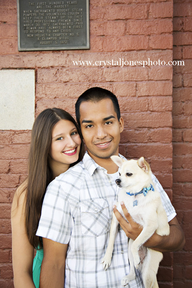 Adorable couple poses for photos with their dog