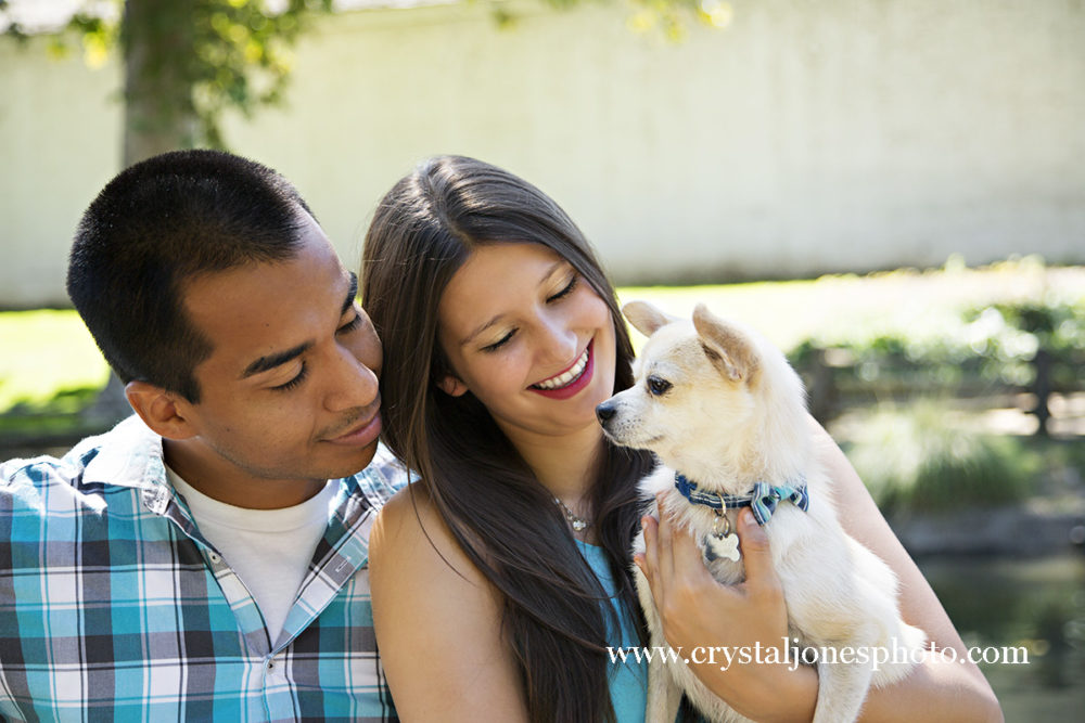 Adorable couple poses with their dog at Sutter's Fort in Sacramento
