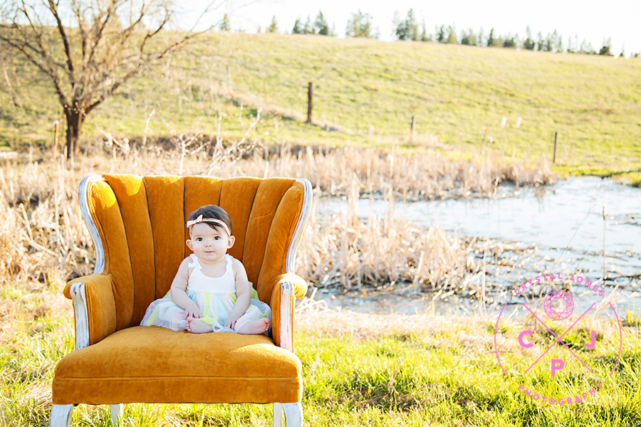 8 month old baby girl in vintage orange chair