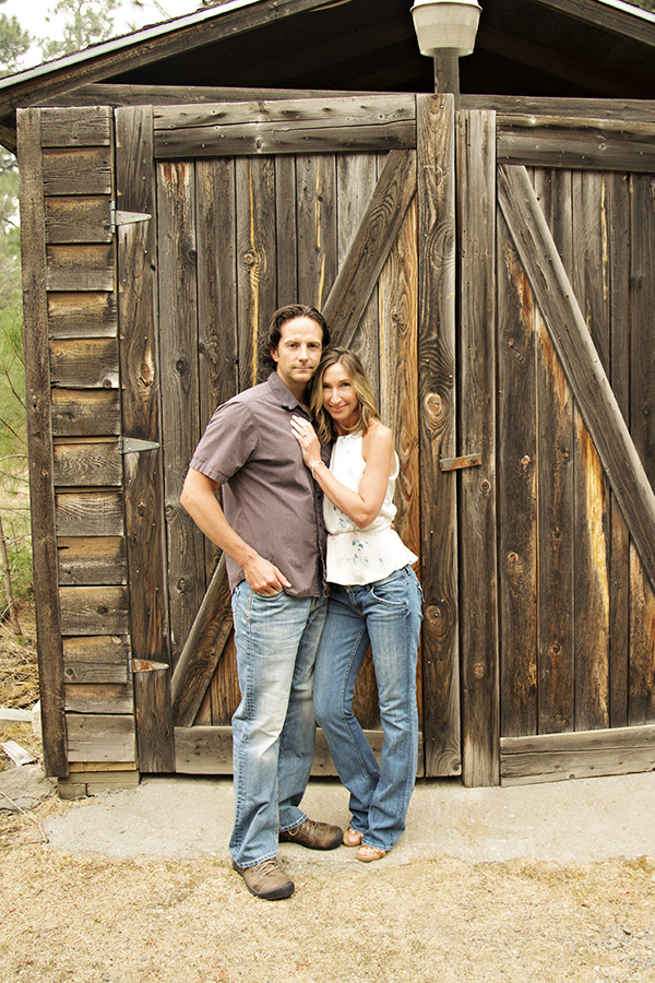 Rustic Engagement Portraits in front of Barn